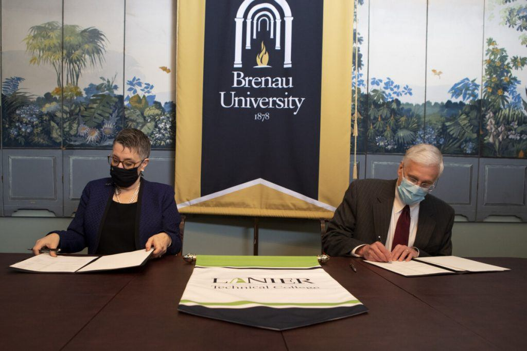 Lanier Technical College and Brenau University have collectively signed a program articulation agreement